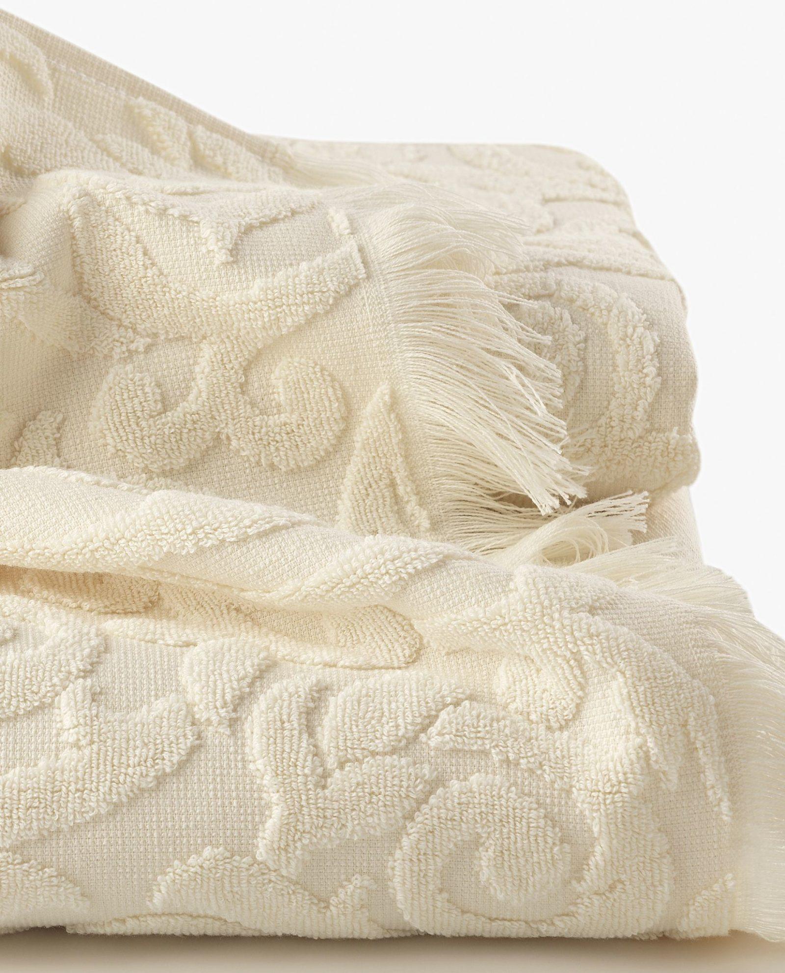 toalha de rosto em tecido bege